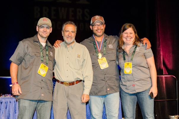 Piney River Brewing received their gold medal at the 2013 Great American Beer Festival awards ceremony held in Denver on Saturday morning.  Shown here, left to right:  Lucas Clem, brewer; Charlie Papazian, president of the Brewer's Association; Brian Durham, head brewer and co-founder; Joleen Durham, co-founder and original keg washing queen. Not present, Amber Powell, brewer.